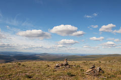 Rock cairn at the top of the world Royalty Free Stock Image
