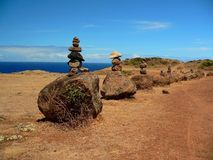 Rock Cairns at a Trailhead. Stacked rocks on boulders at the head of a trail Stock Images