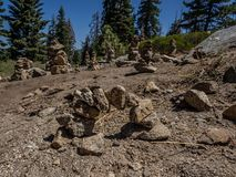 Rock cairns. Whimsical rock cairns litter a rock outcrop at a roadside viewpoint in Sequoia National Park in California stock photography
