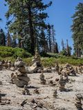 Rock cairns. Whimsical rock cairns litter a rock outcrop at a roadside viewpoint in Sequoia National Park in California royalty free stock images