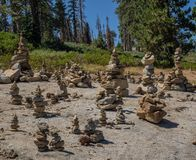Rock cairns. Whimsical rock cairns litter a rock outcrop at a roadside viewpoint in Sequoia National Park in California stock photo