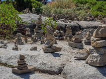Rock cairns. Whimsical rock cairns litter a rock outcrop at a roadside viewpoint in Sequoia National Park in California stock images