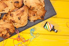 Rock cakes party food in close up with party popper streamer. Si stock image