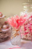 Rock Candy at Buffet Table. Rock sugar crystal candy sticks at a dessert candy buffet table at a love themed pink wedding reception Stock Photography