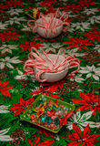 Rock Candy and Candy Canes in bowls on Festive Tablecloth Royalty Free Stock Photo