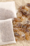 Rock candy sugar and tea bags Stock Images
