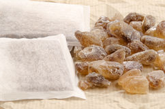 Rock candy sugar and tea bags Royalty Free Stock Image