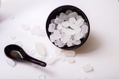 Rock sugar. Rock or candy sugar on a wooden background Stock Photos