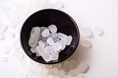 Rock sugar. Rock or candy sugar on a wooden background Stock Photo