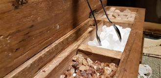 A group of rock sugar. Brown sugar cubes in wooden box . Various tea and various kind of sugar on wooden table. Rock candy sugar in wooden box. Brown sugar cubes royalty free stock photo