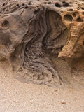 Rock carved by nature. Sandstone deeply carved by nature forces creates and interesting pattern and texture Stock Images