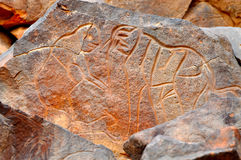 Rock Carving of Elephant. Figure of several animals including an elephant in a prehistoric carving in rock at Uan Amil in the Libyan Sahara desert stock photo