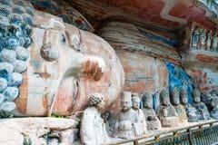 Rock carving of Sakyamuni Buddha entering Nirvana, with his disciples Stock Photos