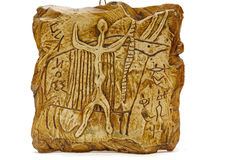 Rock carvings. ( circa I century), ancient men celebrate victory over buffalo Stock Image