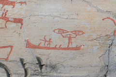 Rock carvings fishing with net on a boat. Rock carvings in Hjemmeluft, Alta, Norway Royalty Free Stock Photos