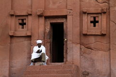 The rock carvings of Lalibela in Ethiopia. Priest at the rock carvings of Lalibela in Ethiopia Royalty Free Stock Images