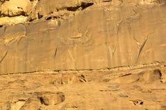 Rock carvings on rocks in the desert. Of Wadi Rum Stock Images