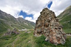 Rock in Caucasus mountain valley with grass Royalty Free Stock Images