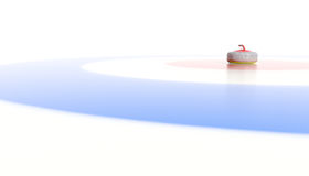 Rock in center of house. Curling rock dead center of circles Royalty Free Stock Image