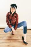 Rock chick in leather jacket, full length. Fashion portrait of elegant woman, studio shot Royalty Free Stock Image