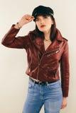 Rock chick in leather jacket, full length. Fashion portrait of elegant woman, studio shot Royalty Free Stock Photos