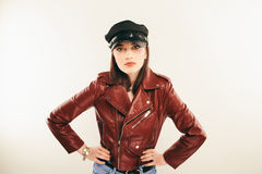 Rock chick in leather jacket, full length. Fashion portrait of elegant woman, studio shot Royalty Free Stock Photography