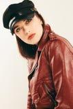 Rock chick in leather jacket, full length. Fashion portrait of elegant woman, studio shot Stock Photos