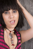 Rock chick with pierced tongue Royalty Free Stock Images