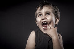Rock, child rocker dress and funny expressions crested Royalty Free Stock Photos