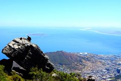 Rock and City. Seen from the Table Mountain.A huge rock stand with cape town city.In distance is Robben Island that Mandela was confined to the island for more stock photography