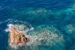 Rock in the clear water of Atlantic ocean. Madeira island, portugal stock photography