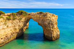 Rock cliff arch near Marinha beach. And blue sea on coast of Portugal in Algarve region Royalty Free Stock Images