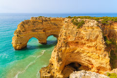 Rock cliff arches on Marinha beach. And turquoise sea water on coast of Portugal in Algarve region Royalty Free Stock Image