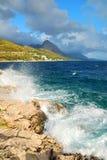 Rock Cliff Blue Sea Waves Stock Photos