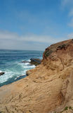 Rock Cliff into the California ocean. Taken at Cabriilo national monument park San Diego Stock Photo