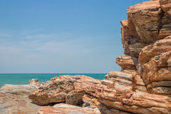 Rock cliff foreground and sea background Royalty Free Stock Image