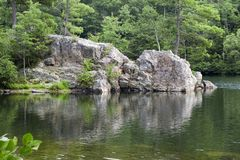 Rock Cliff Lake. Rocks in Rock Cliff Lake, West Virginia (USA), on a sunny summer afternoon stock photo