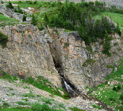 Rock cliff and mountain creek Royalty Free Stock Images
