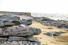 Rock on cliff by ocean. Royalty Free Stock Images