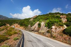 Rock cliff paved road in Corsica Royalty Free Stock Photo