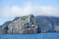 Rock cliffs in clouds stock photo