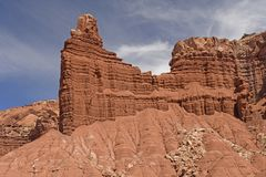 Rock Cliffs Emerging out of the Sand Royalty Free Stock Photo