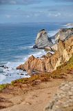 Rock cliffs by the sea Stock Photography