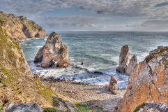Rock cliffs by the sea in HDR Royalty Free Stock Photo