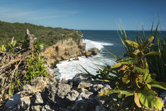 Rock clifs of insonesian seashore near the beach Ngobaran Stock Photography