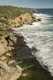 Rock clifs of insonesian seashore near the beach Ngobaran Stock Images
