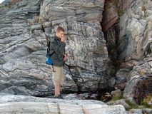 The rock-climber 03. The young man trying the forces in mountaneering royalty free stock photo