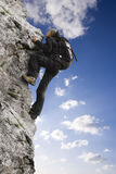Rock climber. Young woman climbing on the rock royalty free stock photography