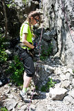 Rock climber. Young girl getting ready for rock climbing Royalty Free Stock Image