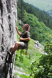 Rock climber. Young man in rappel after successfully climbing to the top Royalty Free Stock Images